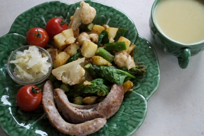 browned local pastured brautwurst, saute of asparagus, spinach, leftover baked potato, & leftover steamed cauliflower, with sauerkraut and tea of fresh turmeric, ginger and spices with local raw milk and local raw honey