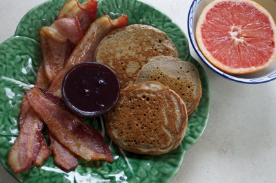 buckwheat pancakes made from buckwheat flour soaked in yogurt overnight, bacon, blueberry syrup, grapefruit, and smoothie of raw milk, berries, collagen powder and banana (not pictured)